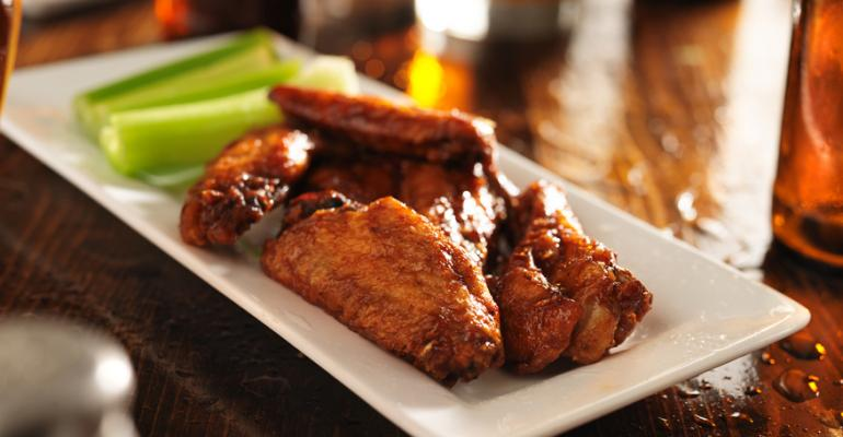 Chicken wings soar on menus