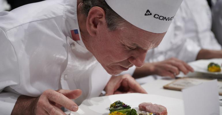 Thomas Keller inspects a dish