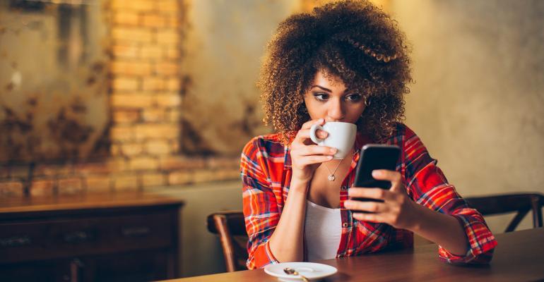 girl on phone in restaurant