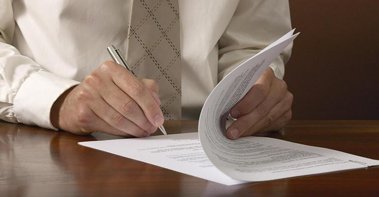 lawyer-signing-document_0.jpg
