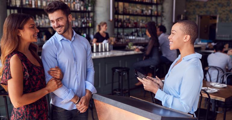 restaurant-hostess-seating-couple.jpg