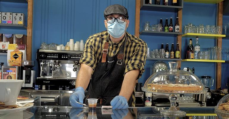 restaurant-worker-wearing-mask-reopening-post-coronavirus.jpg