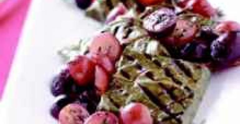 Toma Cheese Wrapped in Grilled Grape Leaves with Red Grapes