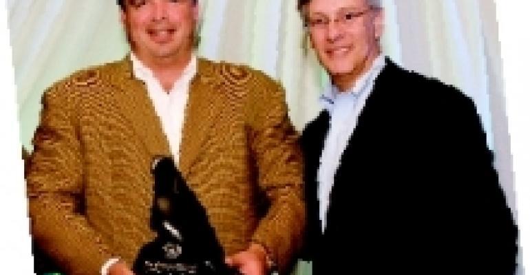 Mitchell Accepts the Melman Award