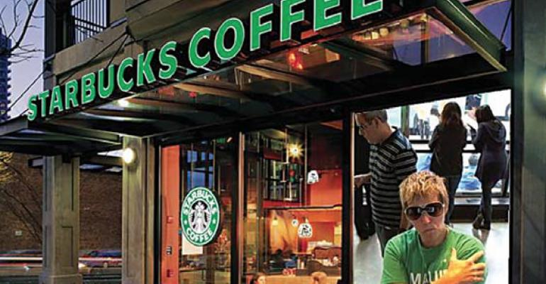 A digital window display right panel shows passerby what39s going on inside this Starbucks store