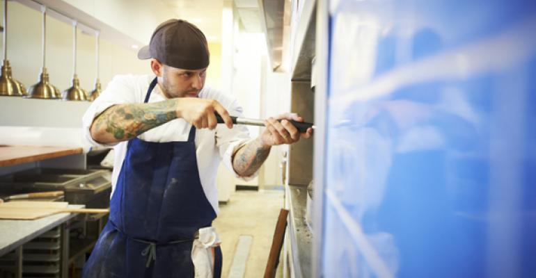 Craft mans the pizza oven at Pastaria