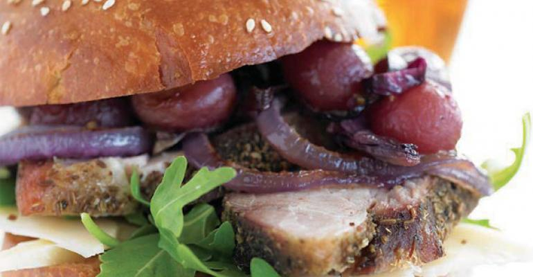 SlowRoasted Porchetta Sandwich with Roasted Grapes Red Onion and Asiago