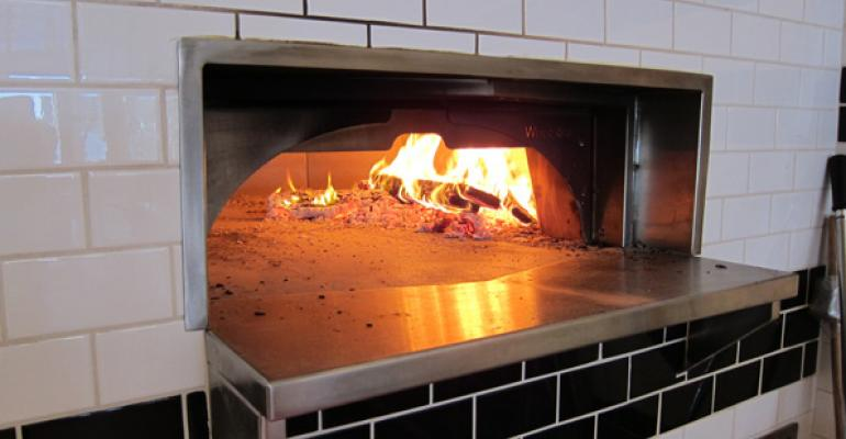 Pizzas cook in one minute in 800 Degrees39 stonehearth oven