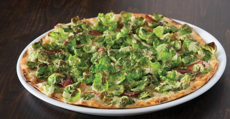 California Pizza Kitchen rolled out a Brussels  Bacon pizza to capitalize on the growing appetite for the longmisunderstood vegetable