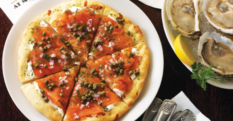 Morton39s The Steakhouse offers smoked salmon pizza and oysters as bar snacks