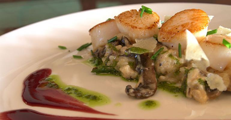 Locally sourced panseared scallops and wild mushroom risotto at Braxton39s Restaurant amp Bar inside the Algonquin Resort