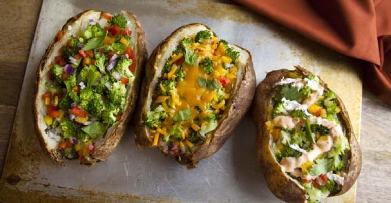 Potatopia customers choose from a variety of toppings organic vegetables a protein cheese and a signature sauce