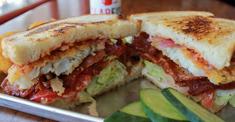 The Crispy Frito Crusted Catfish BLT from Chef Andrew Gruel of SlapFish