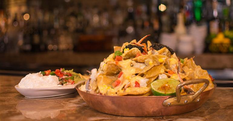 Brennanrsquos of Houston will offer the overthetop Blue Crab and Caviar Nachos 100 featuring Fire Roasted Corn St Andre Queso Alligator Pear avocado Mirliton Pico de Gallo and crowned with an ounce of Petrossian caviar