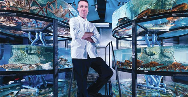 Resort executive chef Thomas Connell stands in ldquowater worldrdquo where fresh fish are stored in tanks until they are cooked