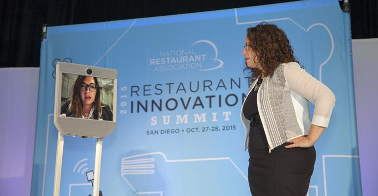 Amy Webb right and Anna Tauzin demonstrate a telepresence robot Beam