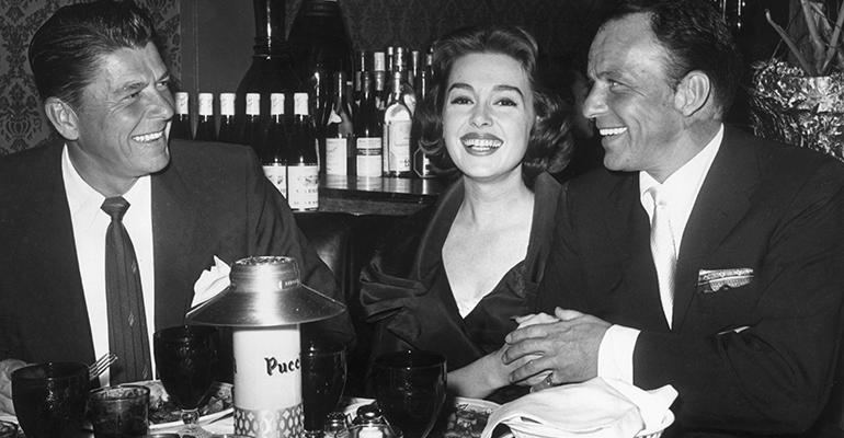 Always a party Actor and soontobe governor and President Ronald Reagan actress Barbara Rush and Sinatra at Puccini39s Restaurant in Beverly Hills in 1959