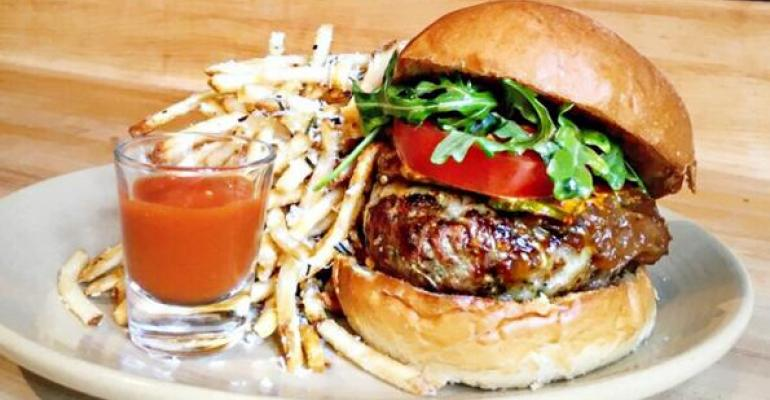 The grassfed beef 55 burger at the Rusty Spoon Orlando satisfies a shift toward grassfed beef and other alternative burger proteins