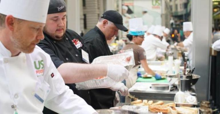 Chef Kenneth Danko second from left of Devilicious in Temecula CA prepares his signature lobster roll on a 50foot line kitchen outside the NYSE last Thursday