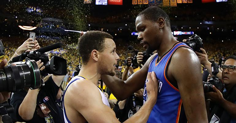 In joining Stephen Curry left and the Warriors Kevin Durant leaves an angry community in his wake