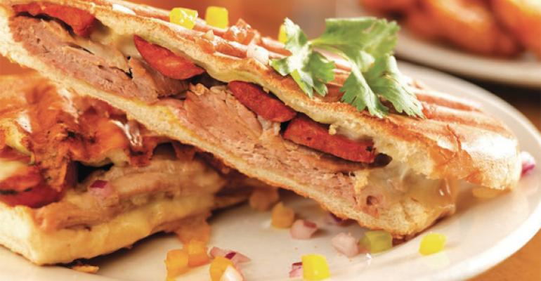The Kubanaso Sandwich at Kuba Kuba features layers of ham slowroasted pork and chorizo