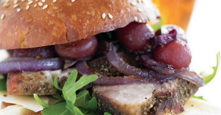 Slow-Roasted Porchetta Sandwich with Roasted Grapes, Red Onion and Asiago