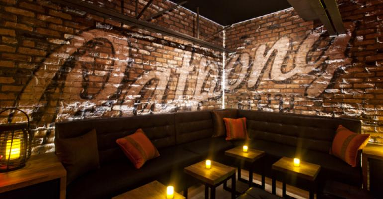 The lounge area of PatPong Road located adjacent to its bar is equipped with custommade brown leather sofas and low tables providing an intimate spot for latenight guests to hang out