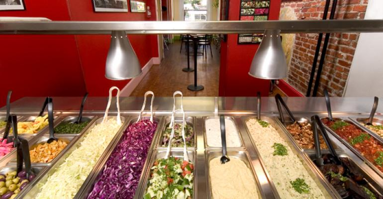 Falafelshop39s garnishing station lets diners customize their order