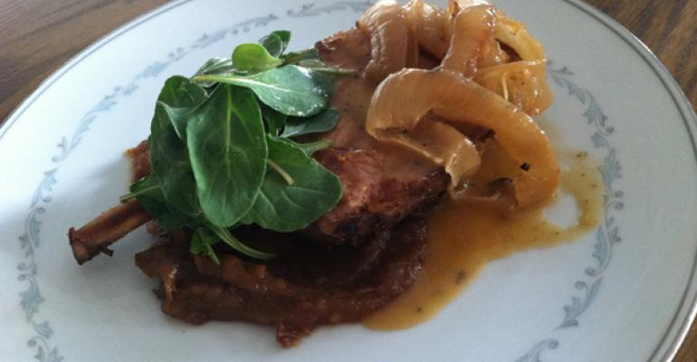 Sweet Tea Brined Pork Chop with wilted greens and data mostardo from Willie Jane in Venice Beach CA
