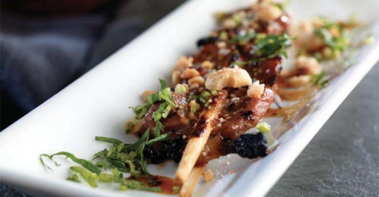 Chopstick Grilled Lemongrass Pork with Black Pepper Caramel, Viet-Herbs and Roasted Peanuts