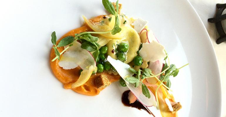 House ricotta ravioli roasted carrot puree English peas radishes ricotta salata and mint at North Pond Chicago