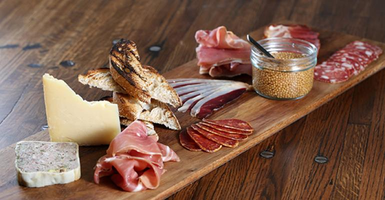The casual dining concept Saltwood in Loews Atlanta Hotel offers rustic presentations including wood blocks that emphasize the restaurantrsquos salted cured meats and charcuterie plates