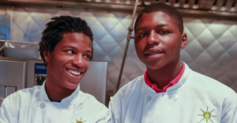 Adolph Martin left and Malik Runnels are two of Cafeacute Momentum39s nearly 200 interns