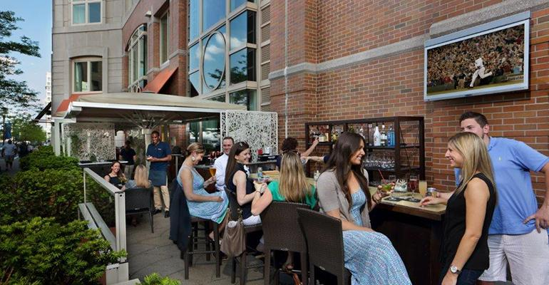 Tamo Bistro amp Bar features some of the key elements of patio design including a rich landscaping a variety of seating types entertainment and adequate shade via generously sized canopies