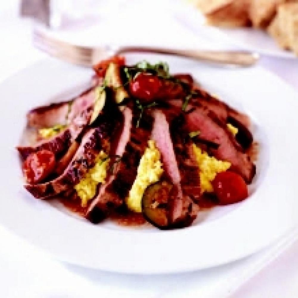 Grilled Veal Flank Steak with Zucchini, Tomatoes & Olives over Creamy Polenta