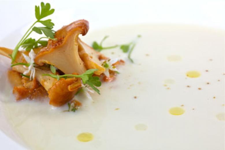 Corn soup with pickled chanterelles and pistachio oil