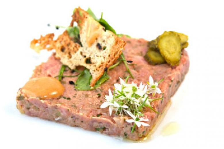Steak tartare with olive oil and caper